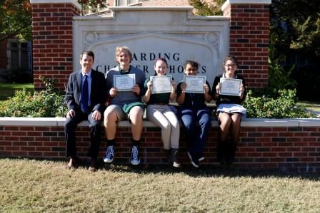 The October 2017 Awesome Eagles with principal Dr. Mylo Miller: Gage Catteeuw, Jesslyn Chain, Monica Money and Lydia Sharpe.