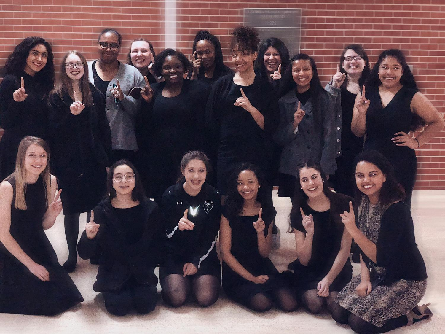 The Women's choir  celebrates their Superior rating after their performance at district contest.