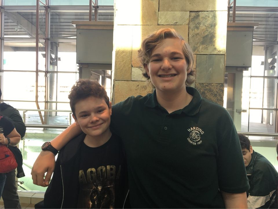 Gage Catteeuw, right, and his French exchange friend Sasha, left, share a moment in Will Rogers World Airport.