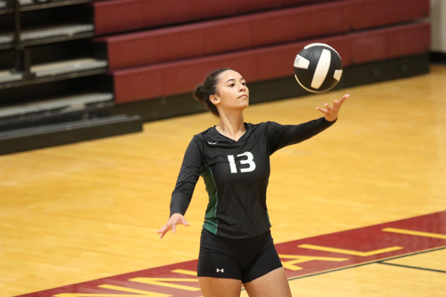 Senior Emily Popielec serves the ball in a game against Seminole Charter on Sept. 3.