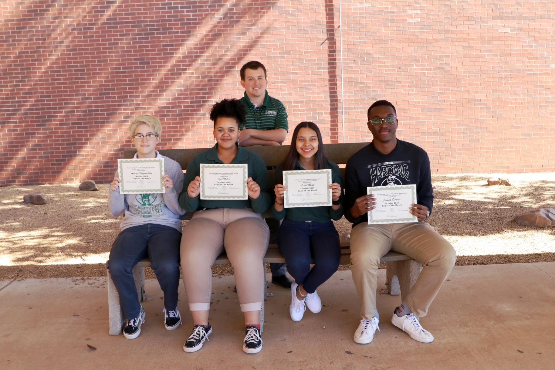 From left to right: freshman Vinny Langsworthy, sophomore Tori WIles, junior Leah White, and senior Joseph Onema with Principal Steven Stefanik in the back.