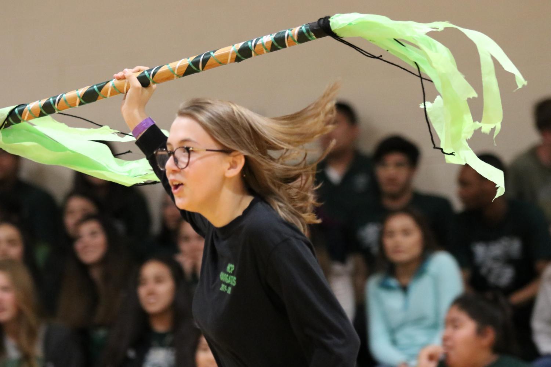 Senior Katelynn Solf runs with the spirit stick at the Spirit Week assembly.